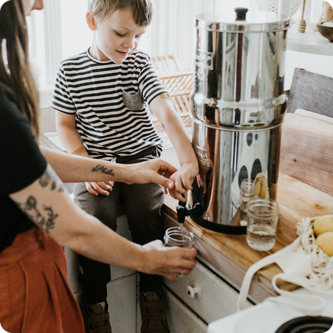 Little boy and mom pouring Berkey water