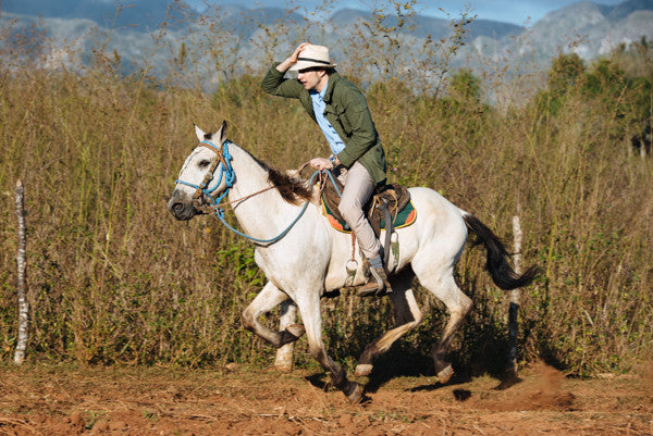 Stefan wearing Bluffworks Originals - the best pants for hot weather - while riding horses in Cuba.