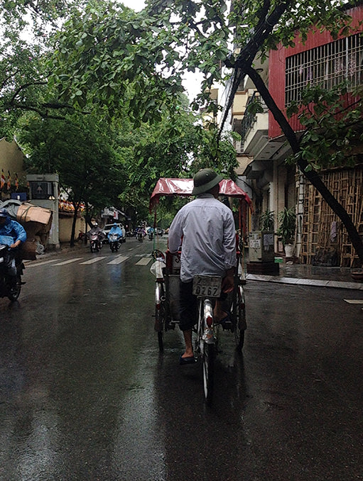 Riding a bike through Hanoi