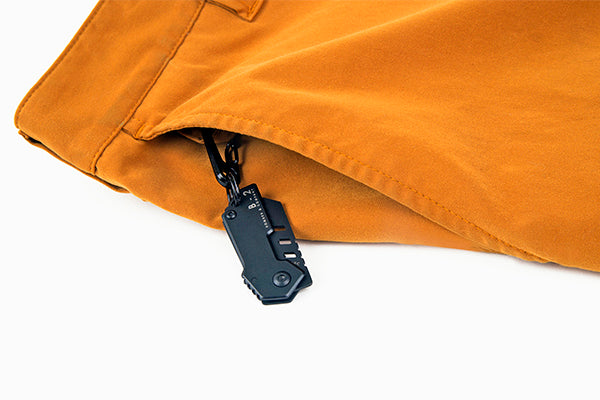The Bomber nano blade in the key ring of our Chinos.