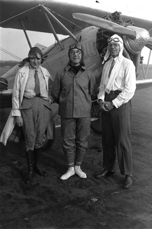 Pilots in Berlin outfitted in their specialized travel gear for aviation.