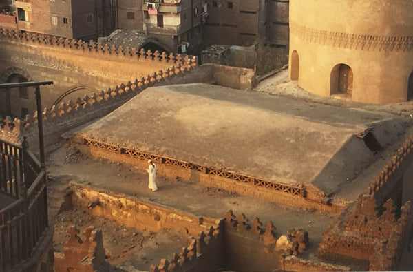 Man walking in Cairo during the late afternoon.