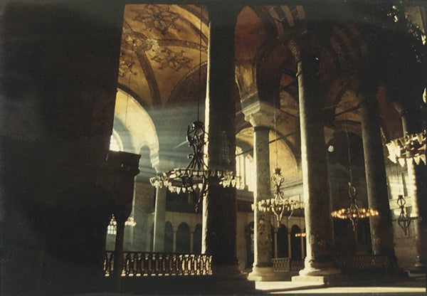 Dramatic light flowing through the architecture of the Hagia Sophia.