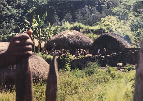 Entering a village in Irian Jaya.