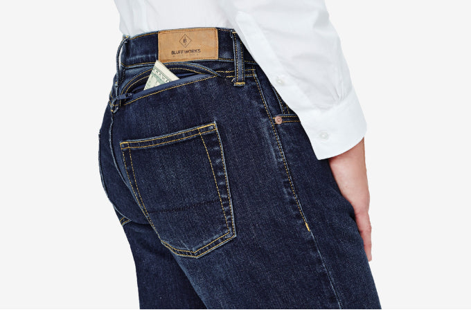 Our travel jeans have traditional denim styling, like bi-color thread and copper rivets, while also being pants with zippered pockets perfect for travel.