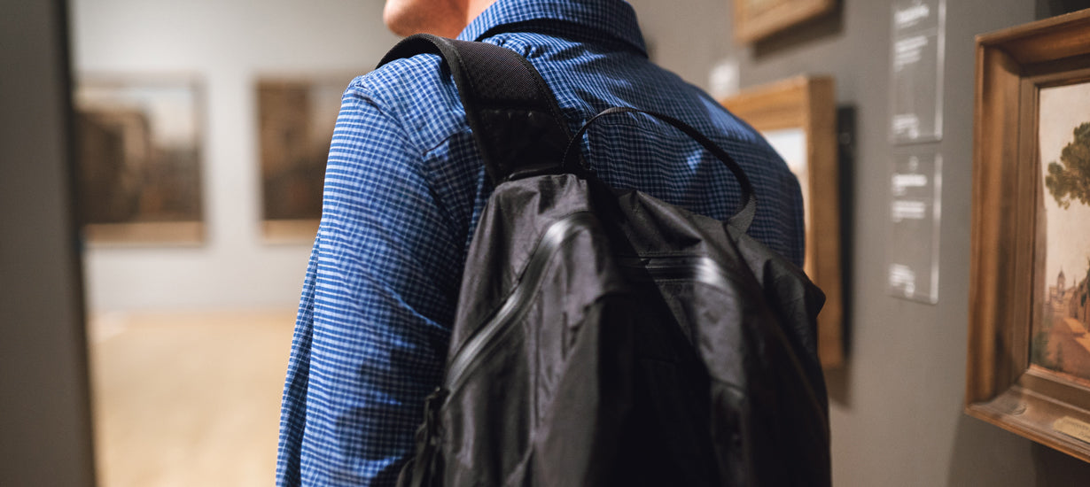 A man wearing a travel backpack.