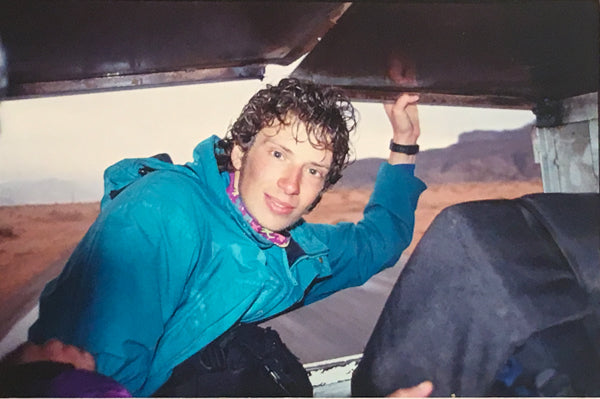 Me hitch-hiking in Jordan as a wide-eyed world traveler in my 20s.