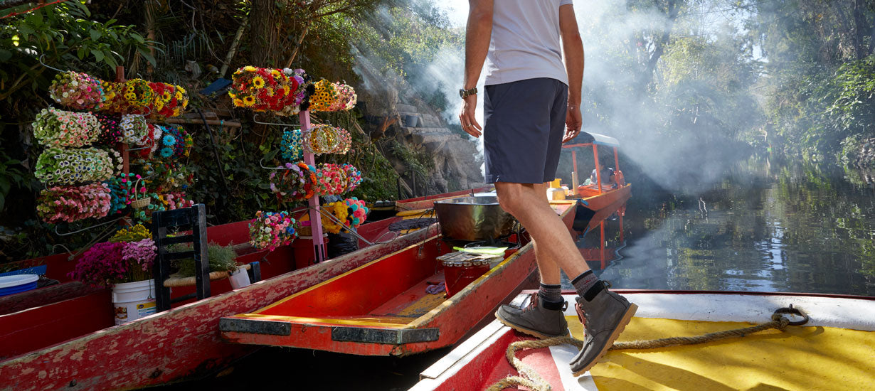Stefan wearing the shorts in Mexico and boarding a boat.
