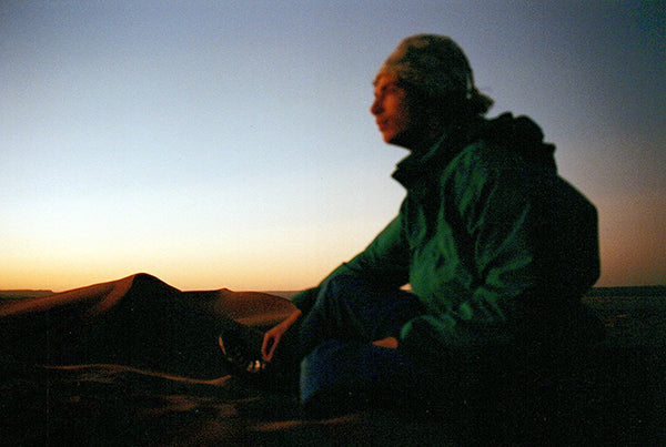 Stefan watching the sunrise over dunes in Morocco 20 years ago.