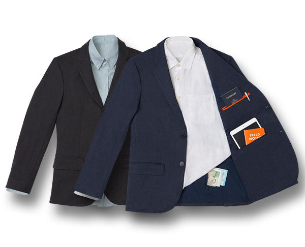 A grey blazer + blue blazer with hidden pockets holding cash, a passport, tablet + notepad.