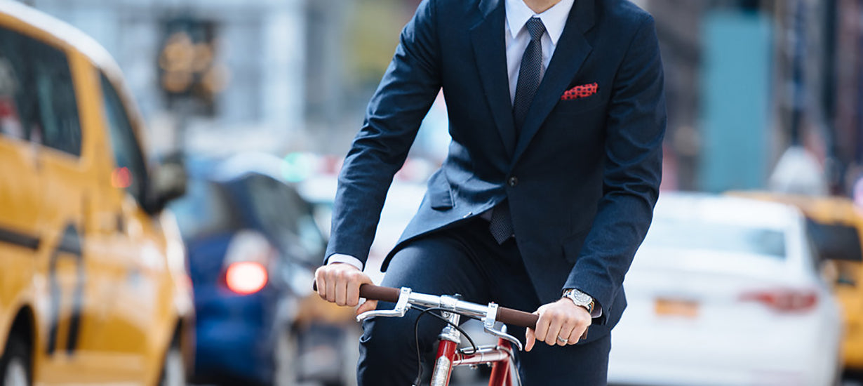 Riding a bike while wearing the Gramercy Suit
