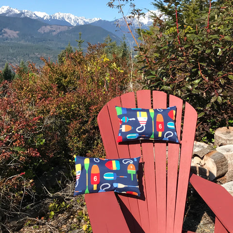Adirondack Chair with pillows on it and mountains in the background
