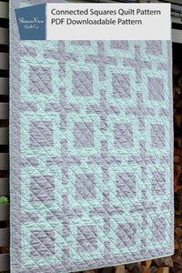 Image of a Shinersview connected squares quilt pattern in gray and light green