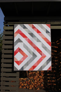 HST Baby quilt with coral and gray
