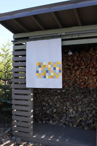 Baby Quilt in Yellow and Gray in a modern patchwork design with lots of white space