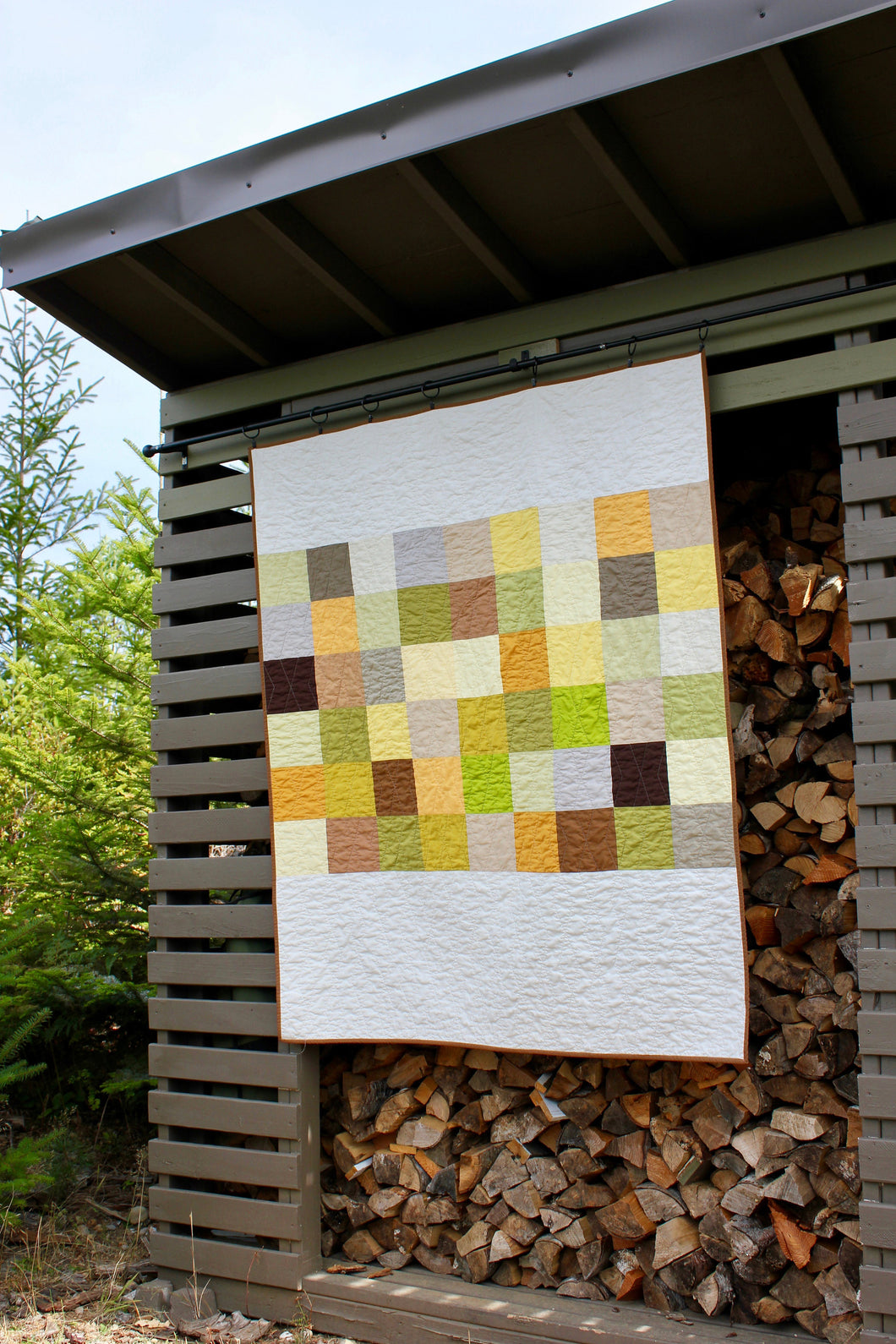 Modern Patchwork quilt in yellow, green and white