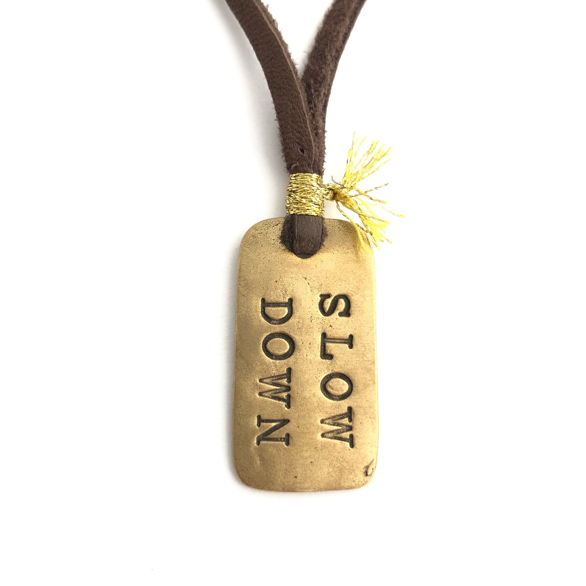 Slow Down Leather And Bronze Dog Tag