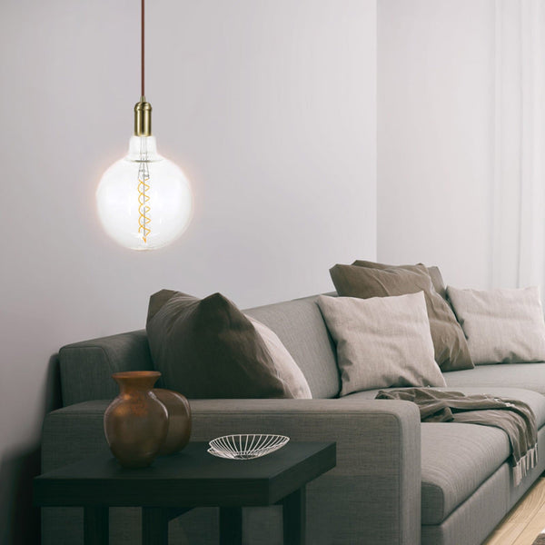 oversize filament globe with single spiral 4w hanging in a living room