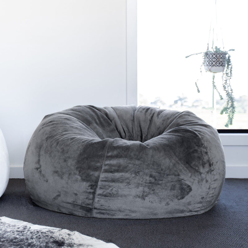fur bean bag in a living room with a cowhide rug