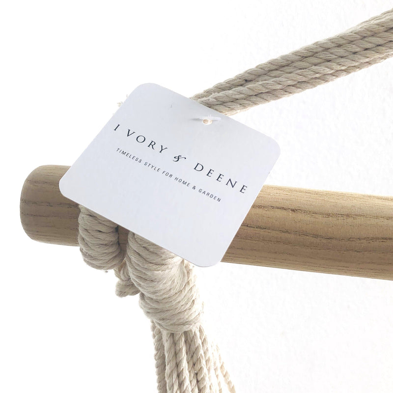 close up of wooden rod and rope from a boho hanging hammock chair
