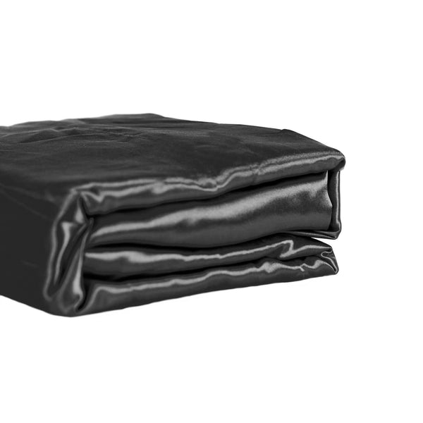 folded set of black satin sheets