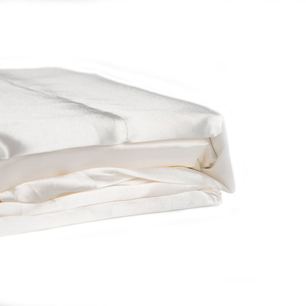 folded ivory satin sheet set from Ivory & Deene