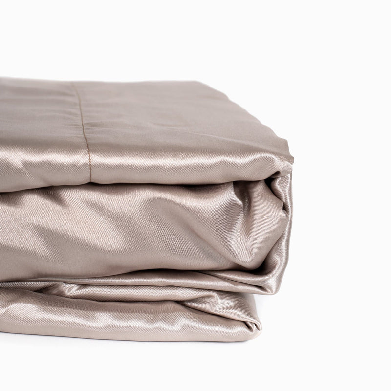 folded champagne satin sheet set from Ivory & Deene