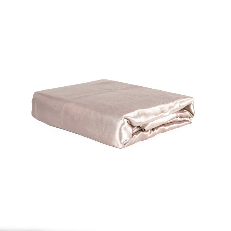 folded champagne satin sheet set on a white background from Ivory & Deene