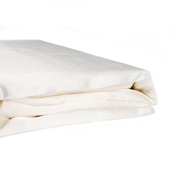 folded ivory satin quilt cover set on a white background from Ivory & Deene