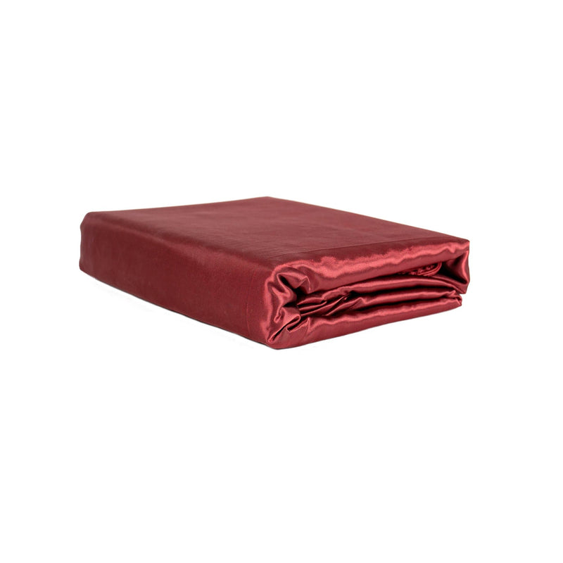 folded wine red satin quilt cover set on a white background from Ivory & Deene