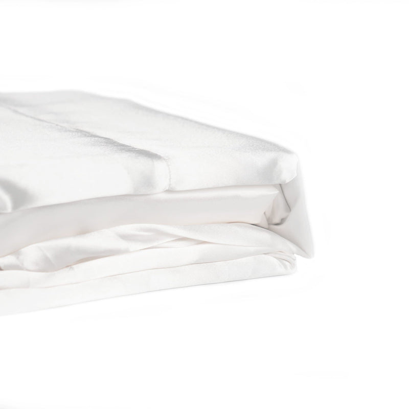 folded white satin sheet set from Ivory & Deene
