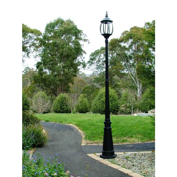 Black Victorian Garden Lamp Post next to a path in a garden