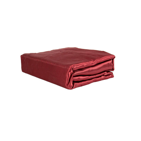 folded wine red satin sheet set from Ivory & Deene
