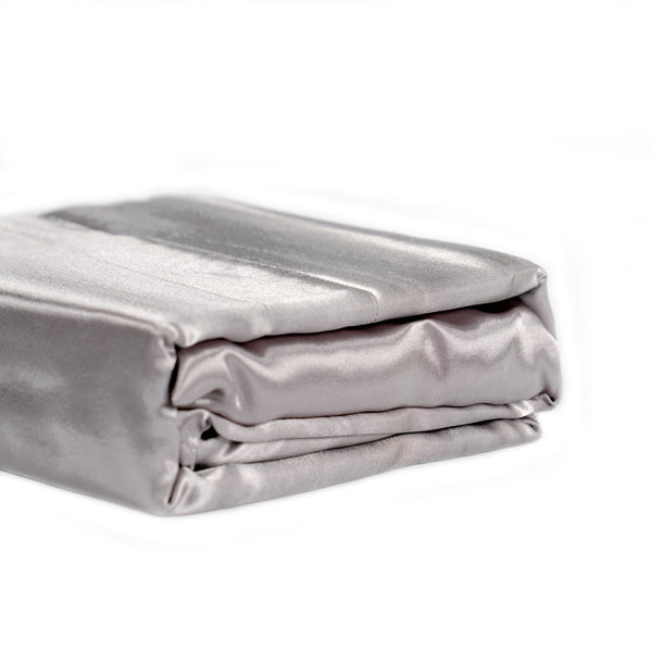 folded silver satin sheet set on a white background from Ivory & Deene