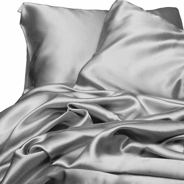 silver satin sheet set on a white background from Ivory & Deene