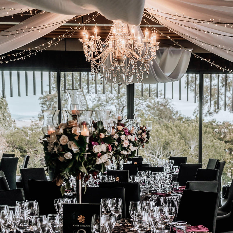 large white chandelier in a wedding reception hall