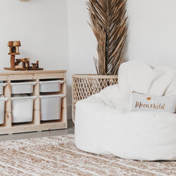 cream beanbag lounger chair in a boho inspired room and a moon child cushion