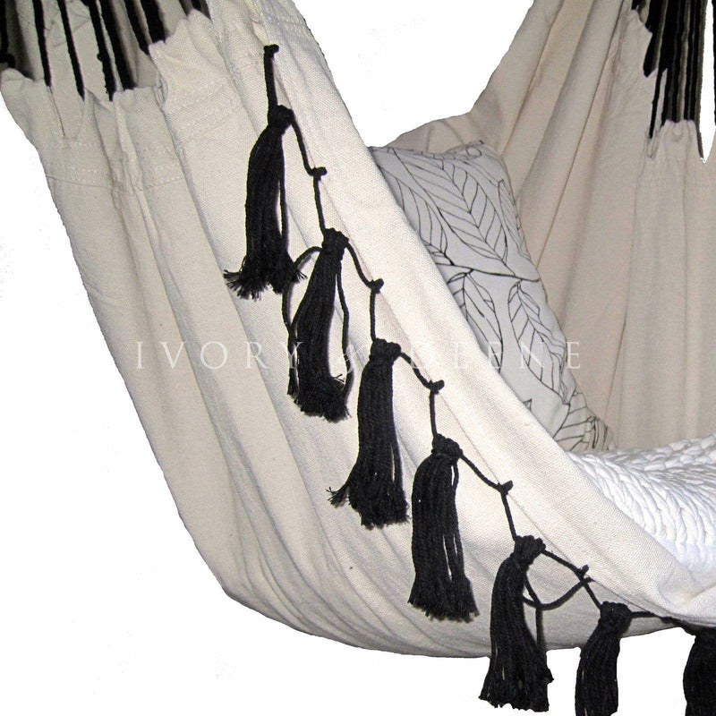 close up of deluxe cream hammock chair with black tassels