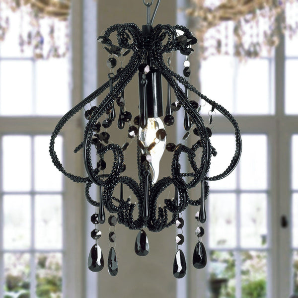 small black dining room chandelier over dining table