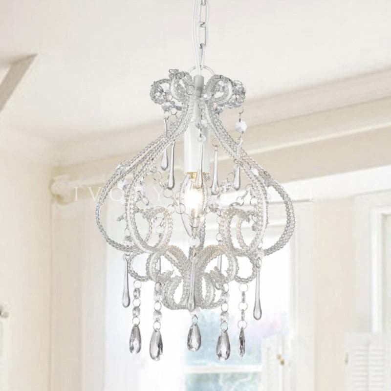 small white shabby chic chandelier in french provincial room