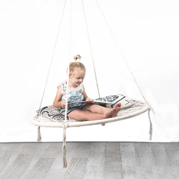 round nest swing hammock with pretty girl reading a book