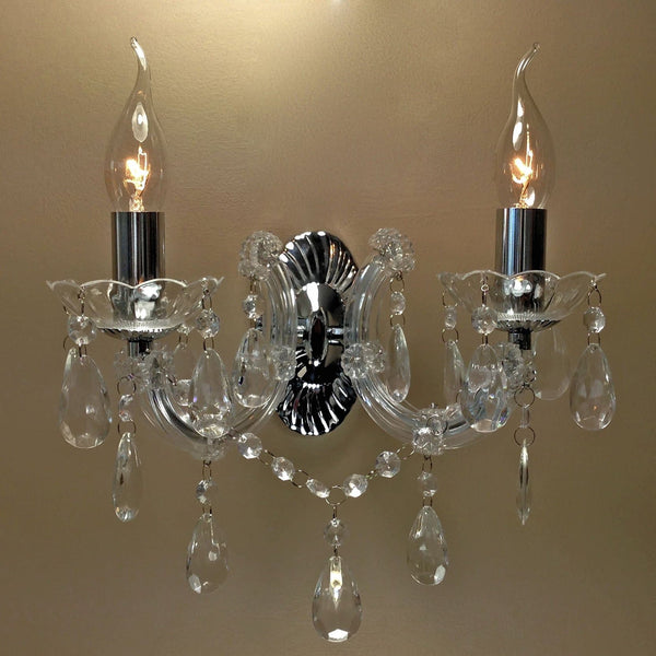 Chrome Marie Therese Crystal Wall Chandelier with the lights on a dimmer