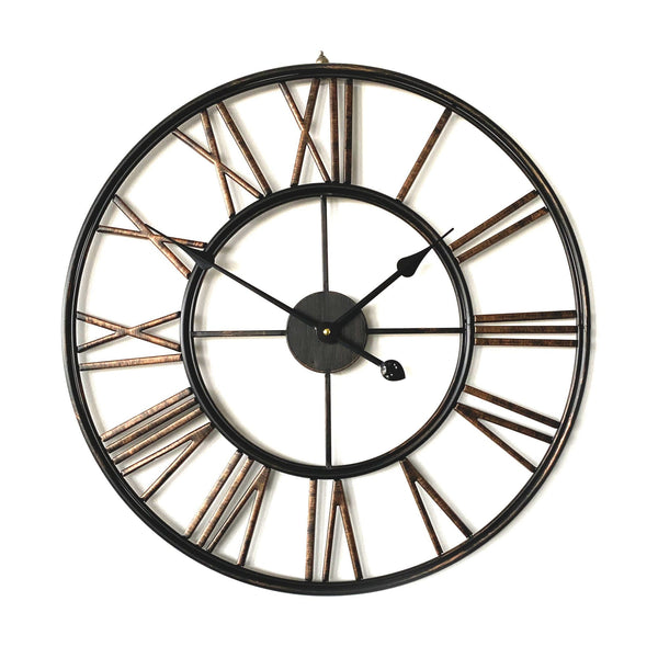 large black bronze metal wall clock on a white background