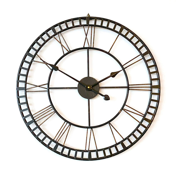 provincial look distressed metal wall clock on a white wall