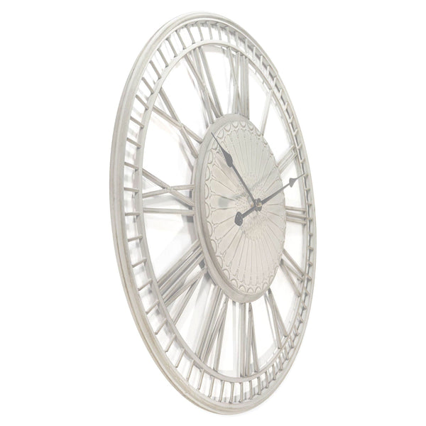 side view of a large shabby chic wall clock on a white background