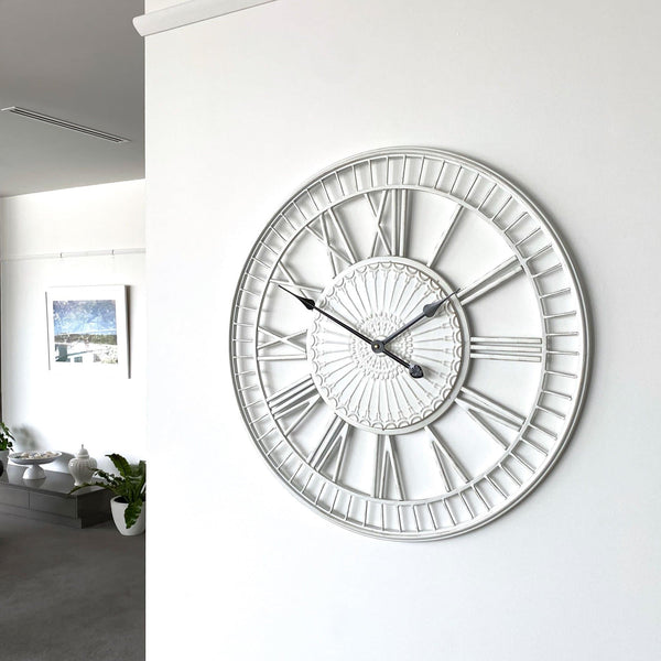 large shabby chic wall clock on a white wall in a living room