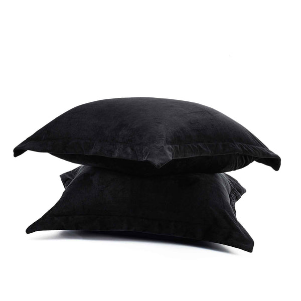 velvet fur pillowcase stacked on top of each other on a white background