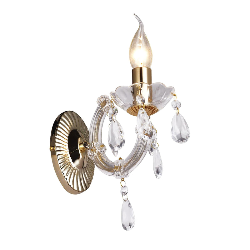 gold grace chandelier on white background with a flame tip globe