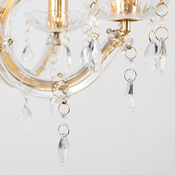 closeup of gold wall chandelier