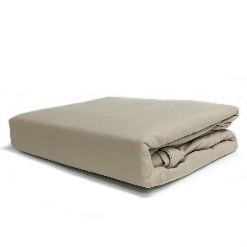 beautiful soft champagne latte quilt cover set folded on a white background
